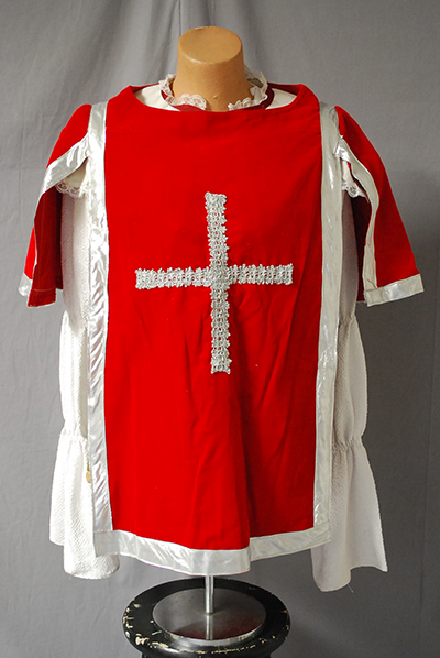 red smock with silver cross over man's blouse (ala Three Musketeers)