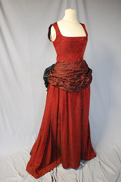 simple red dress with sash/bustle at waist.