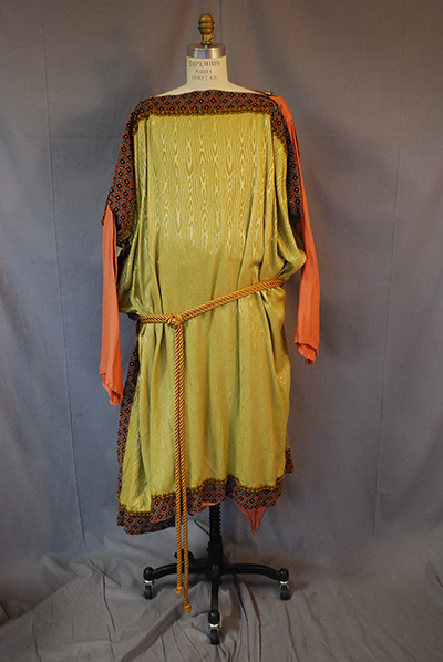 three quarter length tunic with long sleeves. Yellow, brown, orange. Belted at waist.