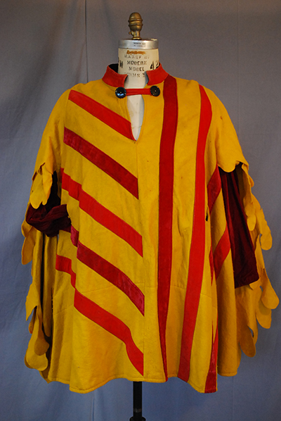 Yellow tunic with bold red stripes.