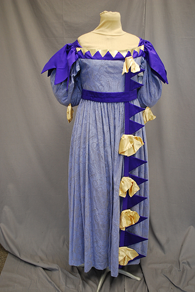 fanciful costume gown of the Romantic period with penant-like purple accessories