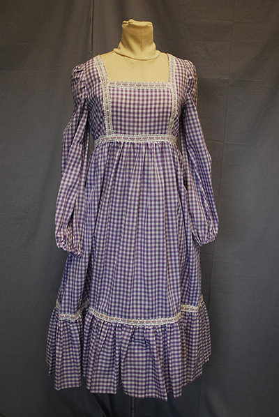purple checked dress with loose sleeves, apron front. Think barn dance.