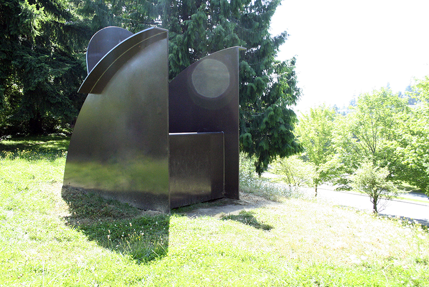 Bigger Big Chair, a large steel sculputure by David Ireland. The chair's sides are quarter circles, with other geometric details at the top.
