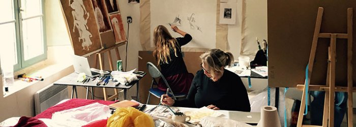 Two women drawing in a studio