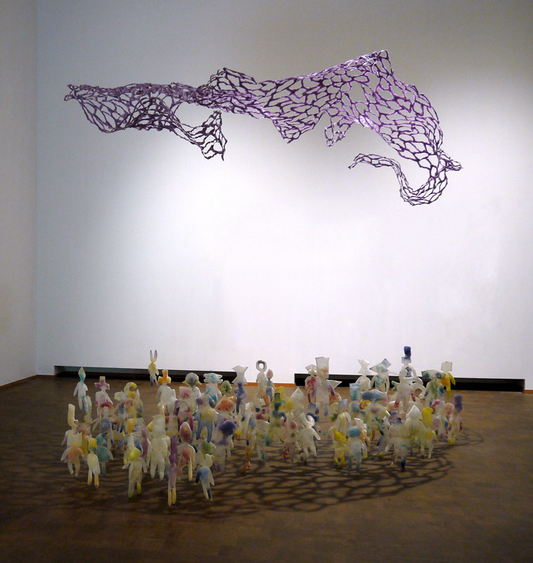 humanoid figures grouped below a floating net
