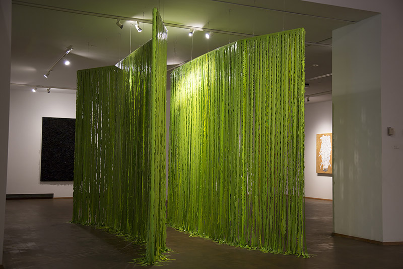 Large curtains of green fiber strands