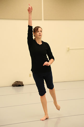 Susan striking an elongated pose with hand over head