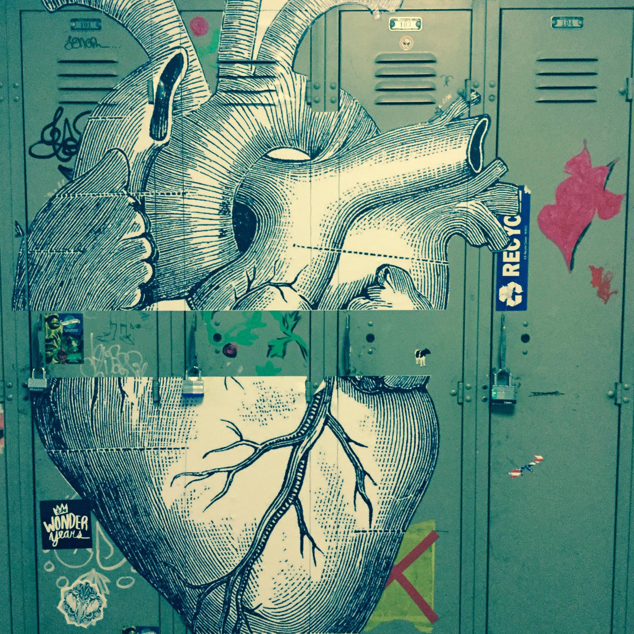 anatomical heart papered onto several lockers