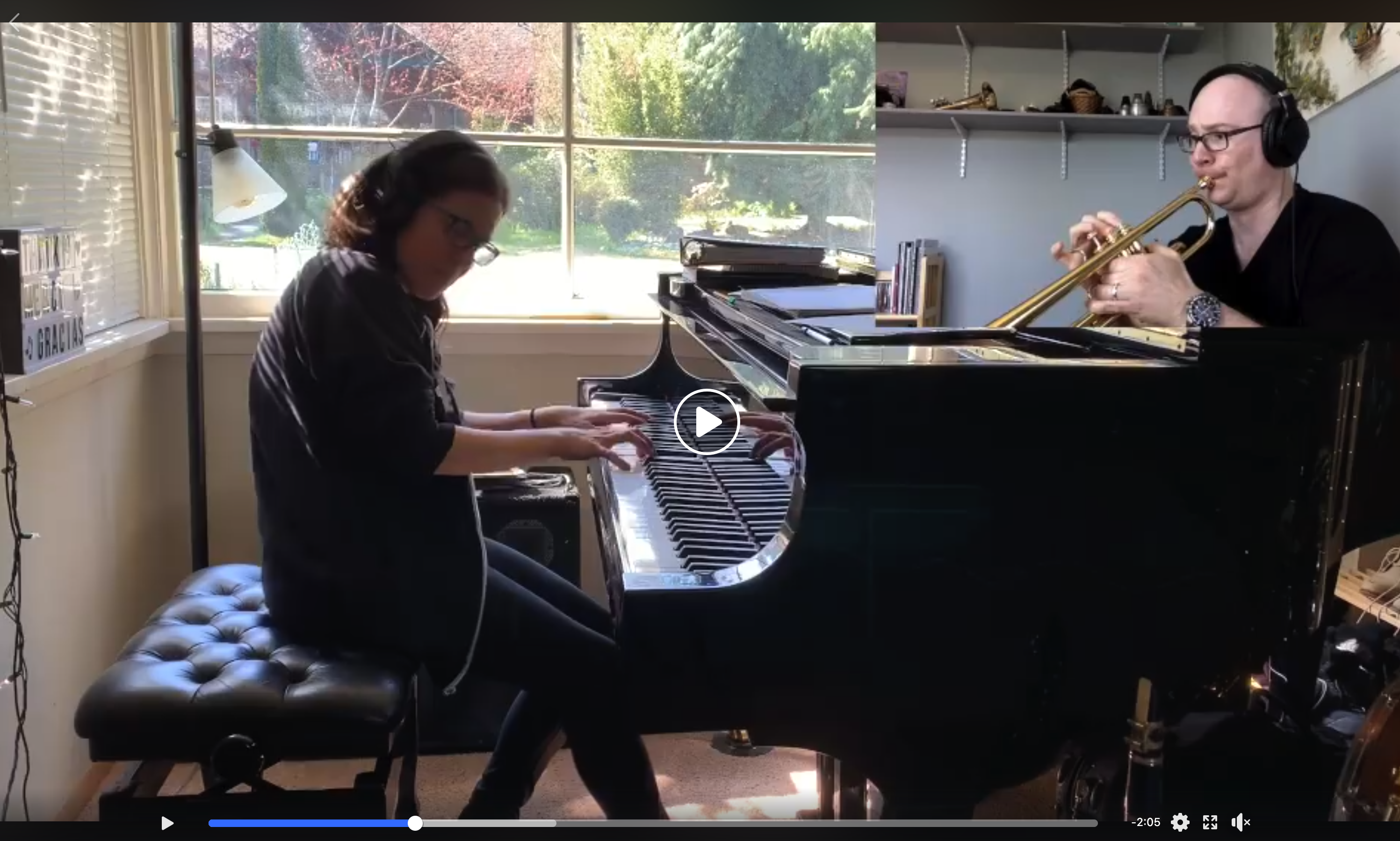 split-screen view of a woman playing piano at home, and a man playing trombone at home