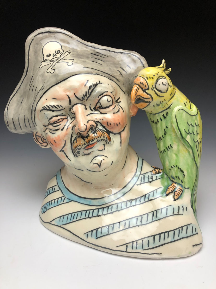 glazed ceramic bust of a leering pirate with a parrot on his sholder