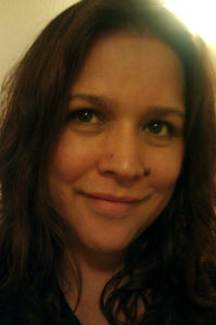 portrait of a smiling person with brown hair