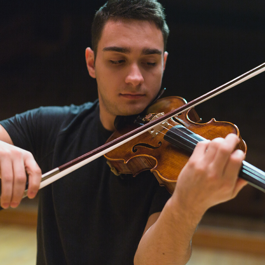 A musician concentrates on playing the violin