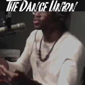 "a podcaster in mid conversation with the title ""The Dance Union"" displayed overhead"
