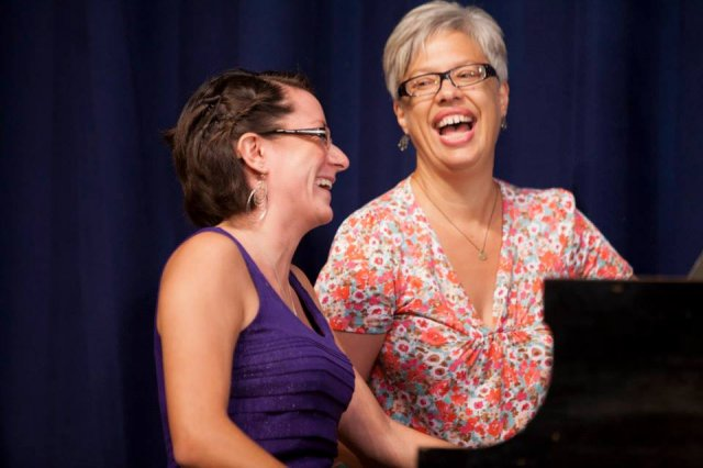 Kathleen Kelly and a student laughing together