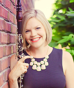 Erika Block holds a clarinet