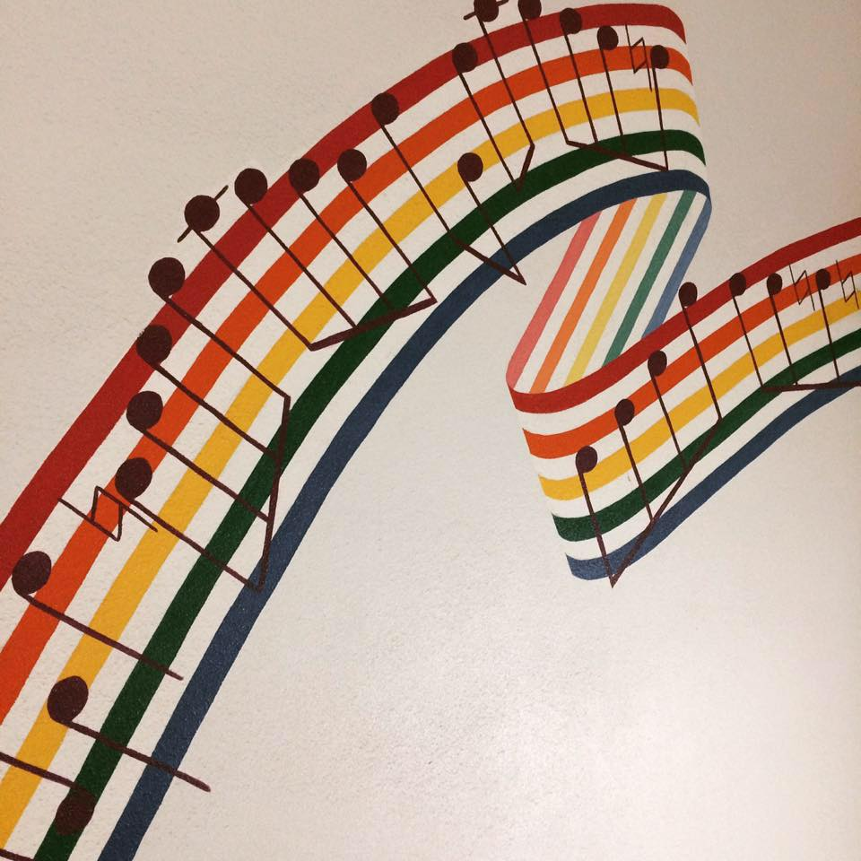 music staff of rainbow colors in an energetic ribbon shape