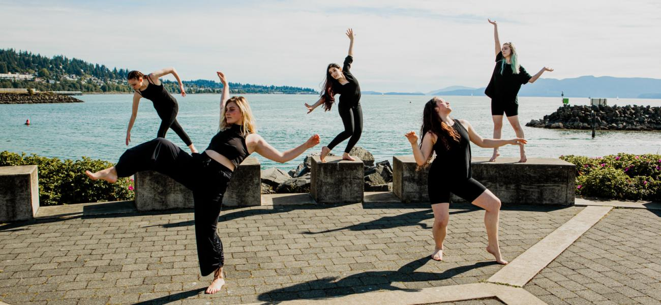 five dancer posing by the bay
