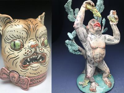 grotesque ceramic figures of a cat head and a demon