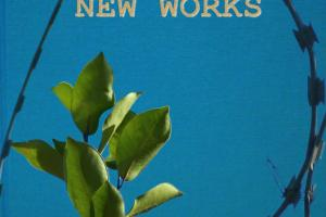 "a sapling growing through barbwire in front of a book titled ""New Works"""
